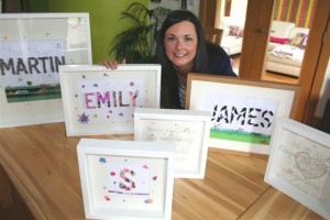 Julie with a selection of her fantastic 'Framed Names'