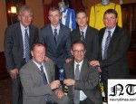 The Office bearers of Newry City AFC are pictured here presenting a memento to MLA Dominic Bradley, in recognition of Local MLAs Karen McKevitt, Danny Kennedy, Mickey Brady and Dominics hard work in helping the club get back on its feet. Pictured  -  Top: Mickey Keenan (Coach), Raymond Byrne (Assistant manager), Darren Mullen (Manager) &amp; Jervaise McCaul  (Coach). Bottom: Martin McLoughlin (Chairman) and MLA Dominic Bradley.