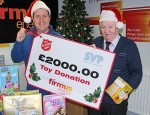 A local firmus team member from Warrenpoint helping to handover a £2000 donation of toys from firmus energy to the St Vincent de Paul and Salvation Army Family Appeal