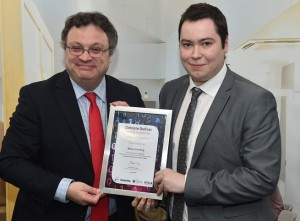 Employment and Learning Minister, Dr Stephen Farry presented a certificate of achievement for completion of the  Deloitte People and Programmes Consulting Academy to Newry graduate Shane Canning