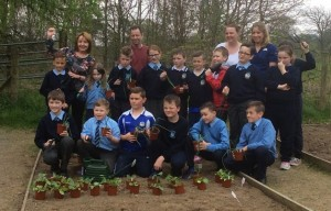 Photo: Cllr Roisin Mulgrew with some of the young School children involved in the Schools Allotment Project