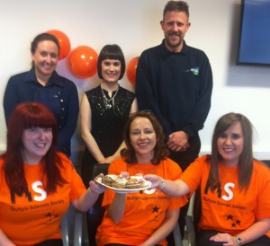 Justina (centre) with colleagues at Kingspan who are getting ready to bake to Stop MS!