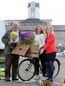 On your bike for business success! Joleen McColgan and Brian Campbell help Lara Goodall get on her bike as together they launch the Market Start Up Programme to find new traders for The Shambles Variety Market in Armagh City