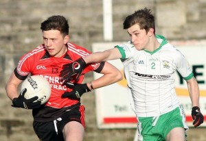 Pete Magee in action for the Minors in their defeat against Burren. Photo| Louis McNally