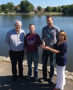 Cllr Mulgrew, Gerard Hughes, chair of the residents committee and council official Paddy Duffy with artist Alan Burke