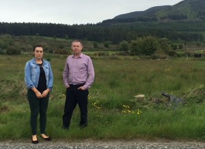 Megan Fearon MLA and Cllr Mickey Larkin at the scene of the crash