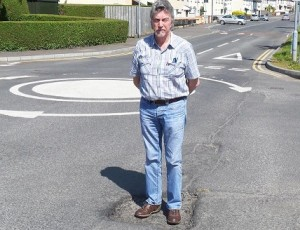 Mickey Brady at a pothole on the Meadow Road