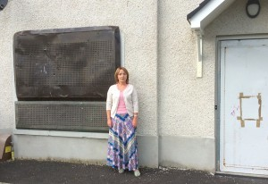 Cllr Mulgrew outside one of the boarded up houses in Dobson's Way