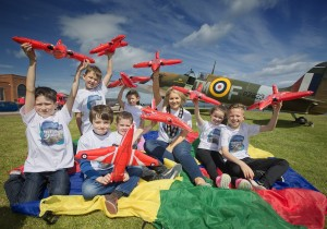 CAPTION: Newry, Mourne and Down District Council Chairperson, Councillor Naomi Bailie was besieged by junior aviation fans as she launched the 2015 B/E Aerospace Festival Of Flight. The event programme is sending summer expectations soaring as the children look forward to the world famous Red Arrows jetting in over Newcastle and Dundrum Bay on Saturday 8 August. The Red Arrows will be part of an amazing display of vintage and contemporary aircraft whirling through the skies while, at ground level Newcastle delivers a packed programme of free family entertainment. Creating their own mini Red Arrows formation display with Cllr Bailie are Ethan (8), Eoin (8) and Zara (6) Smyth, Louis Scullion (7 ), Connor Rooney (4) and Shea (10) and Teagan (8) Clelland.