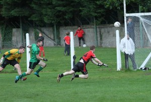 Adrian Mackin palms in the ball for Rostrevor