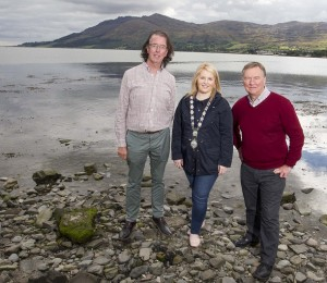 Caption: Newry, Mourne and Down District Council Chairperson, Cllr Naomi Bailie is pictured at Warrenpoint Harbour with Newpoint Players Donal O'Hanlon and Sean Treanor. The Lady Caroline ship set sail to New Brunswick, Canada from this point during the Famine. The Newpoint Players' production 'Retracing The Steps' , will seek to illustrate some of the realities of the Famine as experienced at the time, performed in Warrenpoint on Sunday 27 September at locations by the waterside from 2pm – 3.30pm.