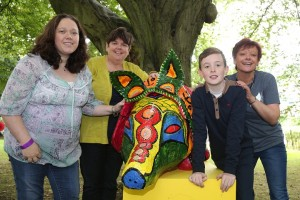 Myles Grant aged 12 a pupil at St Colman's College, Newry is pictured with one of the Fantastical Creatures which he help to create. The creatures took centre stage in the Fantasy Forest part of this year's Belfast Mela Festival. Myles is pictured with (left to right) Sinead Wadforth and Pauline McQuillan Project leaders and Niamh Flanagan ArtsEkta Cultural Coach Project Manager