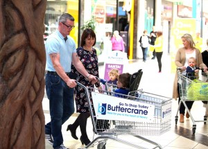 5 year old Odhran O Hare with mum Bevin and dad Stephen try out the new GoTo Shop Trolley available in Buttercrane Shopping Centre