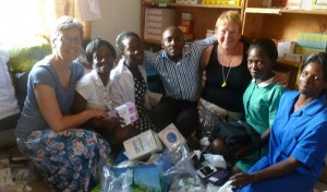 Christine Finlay (far left), Southern Health and Social Care Trust Dentist presenting medical supplies to staff at Rapha Medical Centre, Uganda including Paul Nsonga, Medical Officer (centre).