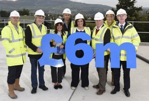 Marking completion of pipelaying on the Ballydougan to Newry Trunk Main Scheme on the roof of the new Crieve Service Reservoir are (L-R) Martin Gillen (NI Water), Mickey Brady MP, Councillor Valerie Harte, Conor Ward BSG Civil Engineering, Councillor Gillian Fitzpatrick, Councillor Charlie Casey, Michael Anderson Capita and Paul Davison of NI Water