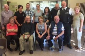 Councillor Roisin Mulgrew with members of the PSNI and various community groups who will be taking part in the new drop in centre