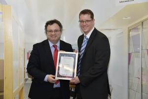 Kevin Johnston from Newry receiving his Deloitte Human Capital Academy certificate from Minister Farry.