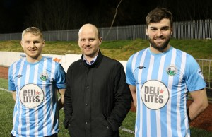 Manager Barry Gray greets the two new signings he captured last night