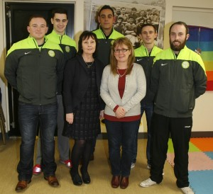 Members of Derrybeg's football team Stefan McKnight, Kevin Pearce, Conor McCartan, Marcus McCartan and Ryan McElroy with Eileen Grant and Michelle Hazlett of the Housing Executive.