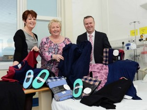 Louise Devlin, Head of Medicine and Unscheduled Care, Edel Corr, Patient Support Manager and Barry Conway, Assistant Director of Medicine and Unscheduled Care, with some of the emergency clothing that the Southern Trust has been able to purchase for patients most in need through generous public donations.
