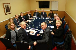 The deputy First Minister Martin McGuinness pictured with the delegation of Councillors and Senior Officials from Newry, Mourne and Down District Council at the Canal Court Hotel, Newry to discuss the Narrow Water Bridge project and the Southern Relief Road. Also featured in the photograph is Pamela Arthurs, Chief Executive of East Border Region (front right) and Tom Reid (Senior Official from DRD - sitting on left of deputy First Minister) and Donal Moran (Senior Official from OFMDFM - sitting on right of deputy First Minister)