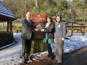 Chairperson of Newry, Mourne and Down District Council, Councillor Mickey Ruane with Michelle Boyle, Tourism Officer and Therese Hamil, ring of Gullion Tourism Officer celebrating Slieve Gullion receiving an award for the Best Outdoor Recreation for Families.