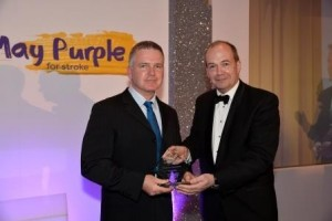 Stroke Northern Ireland Stroke Awards Professioanl Excellence winner Sean Curran with Chief Medical Officer Dr Michael Bride compressed