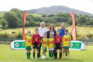 Camlough Rovers FC and Midway United footballers alongside Pat Jennings, Gillian Fitzpatrick (Chairperson) of Newry, Mourne and Down District Council and Seamus Heath from the Irish FA
