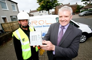 Kirk McGregor from ROL Testing with Cormac McCamphill, NIE Networks. NIE Networks will be working with local contractors to replace over 200,000 meters