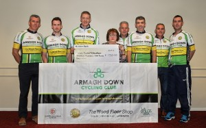 Shelia Carragher of charity partner, Multiple Sclerosis Newry, Hyperbaric Oxygen Therapy (centre) is presented with a cheque by members of Armagh Down Cycling Club