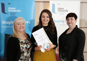 Niamh Downey is presented with the CIM Award for Excellence by sponsor representative Kathryn Pyper (right) watched by Course Director Dr Mary Boyd (left)